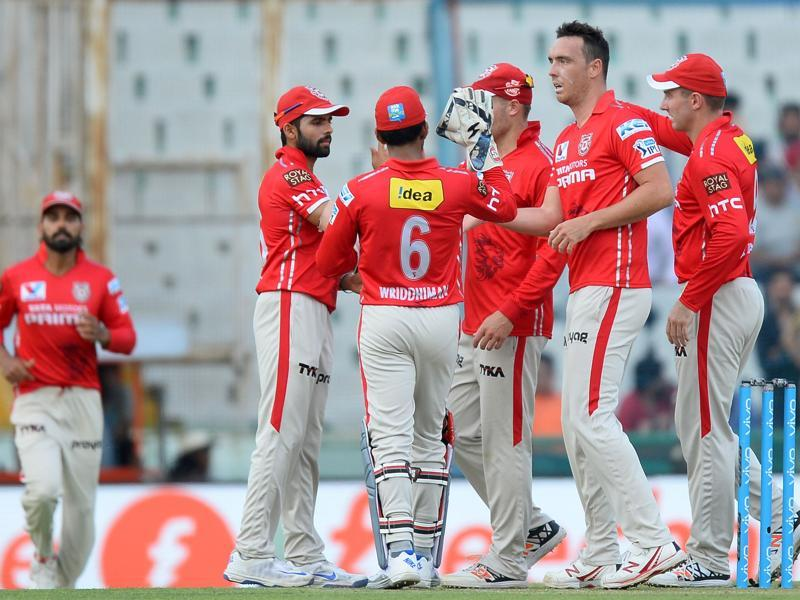 Kings XI Punjab players celebrate with Kyle Abbott (2R) after the dismissal of Rising Pune Supergiants batsman Kevin Pietersen. (AFP)