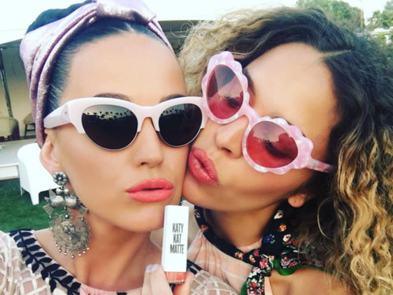 Katy Perry plugs her lip gloss at the festival.  (Instagram)