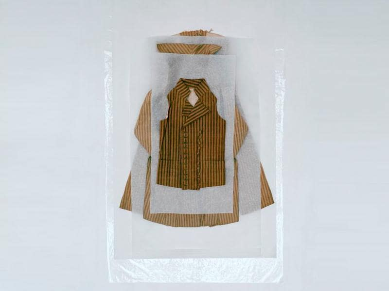 Coat, waistcoat and trousers worn by Louis XVII, Louis Charles de France, Duke of Normandy (1785–1795), circa 1792. It is beige and brown striped cotton with wWooden buttons covered with fabric. (AFP)
