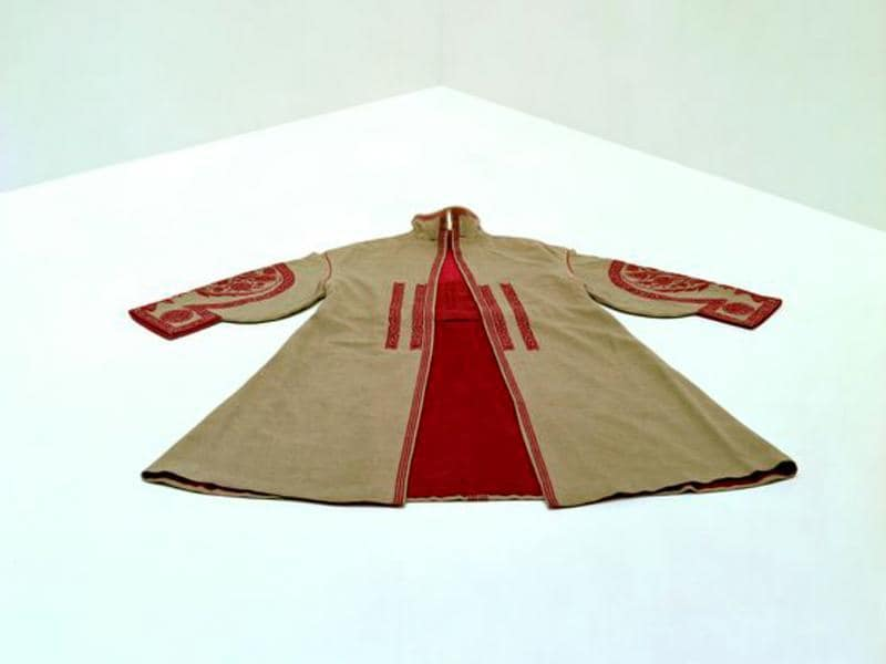 Paul Poiret, day coat worn by Denise Poiret (1886-1982), 1922. It's a beige wool cloth (kasha) with red wool embroidery. (AFP)