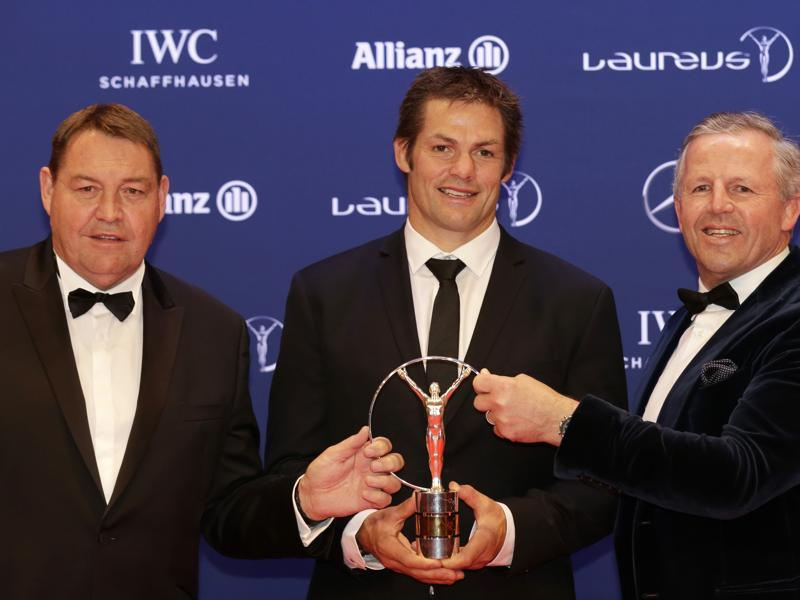 Richie McCaw, center, captain of the All Blacks, and former rugby player Sean Fitzpatrick, right, and New Zealand's head coach Steve Hansen collect the Laureus Team of the Year award on behalf of the All Blacks. (AP)