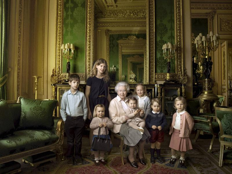 Queen Elizabeth II with her five great-grandchildren and her two youngest grandchildren in Windsor Castle, her official residence. (AP Photo)