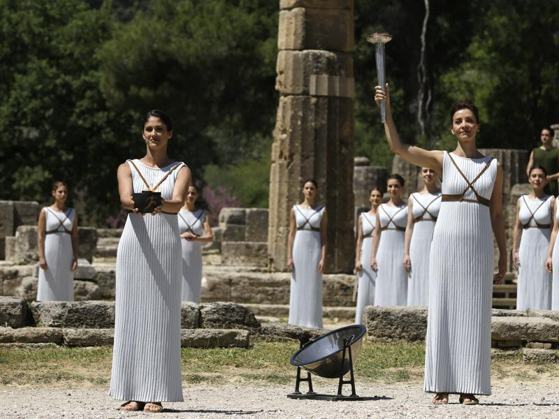 Dancers dressed as priestesses display the Olympic flame during the ceremonial lighting. (AP Photo)
