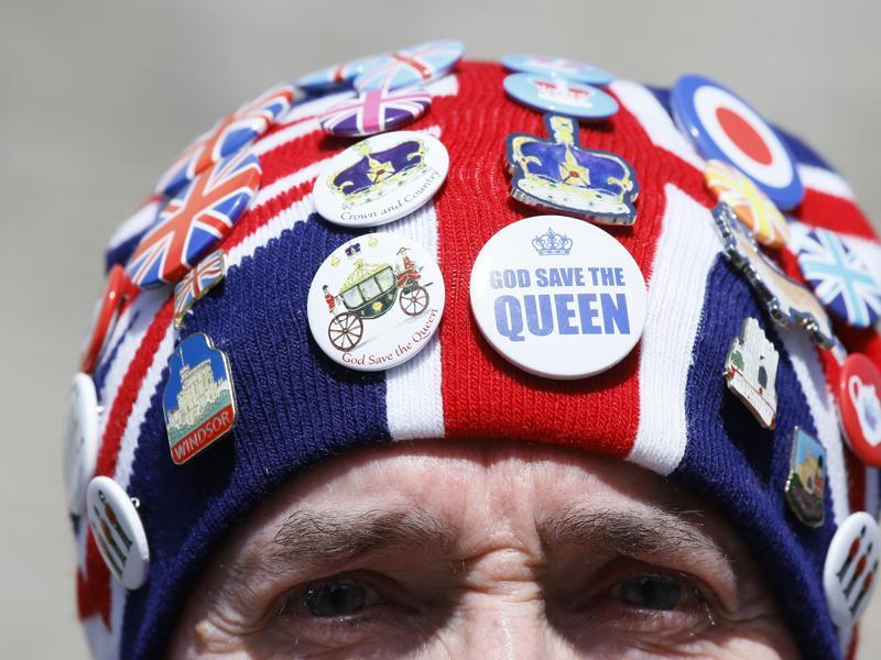 John Loughrey, a royal fan wears a hat covered in badges in Windsor, England, Wednesday, April 20, 2016.  (AP Photo)