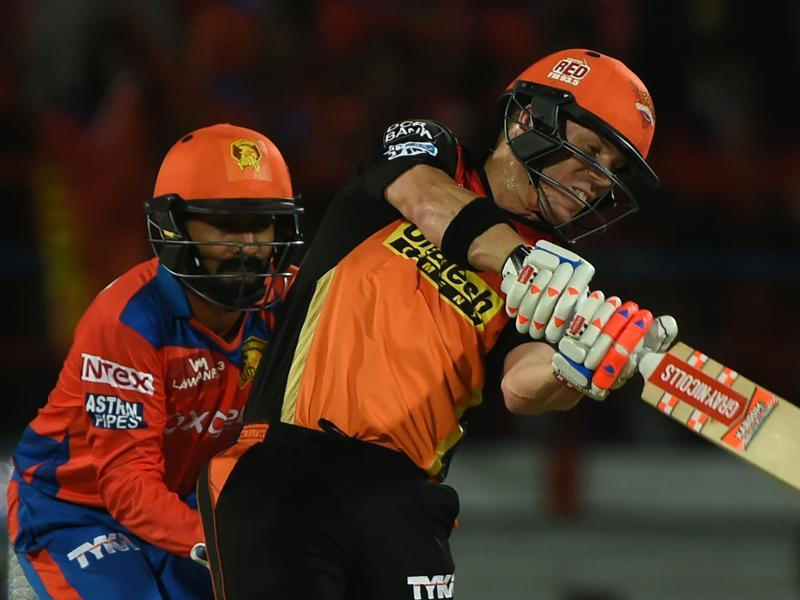 Sunrisers Hyderabad captain David Warner (R) watched by Gujarat Lions wicketkeeper Dinesh Karthik plays a shot during the 2016 Indian Premier League(IPL). (AFP Photo)