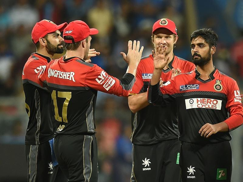 Royal Challengers Bangalore bowler Iqbal Abdulla (R) celebrates with teammates after taking the wicket of Ambati Rayudu. (AFP)