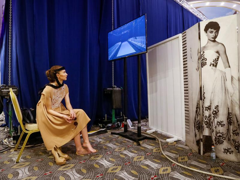 A model waits for a show backstage while being dressed a lot like Audrey Hepburn. (REUTERS)
