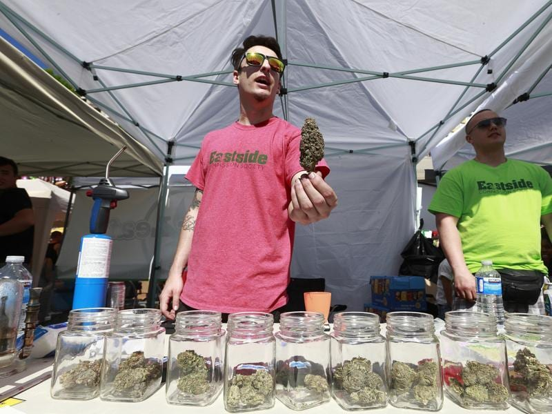 A vendor sells pot as thousands of people gather at 4/20 celebrations on April 20, 2016 at Sunset Beach in Vancouver, Canada.  (AFP Photo)