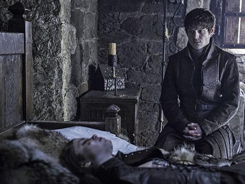 Ramsay Bolton (Iwan Rheon) sitting in front of Myranda's (Charlotte Hope) dead body. She was thrown off the tower by Theon in last season. (HBO)