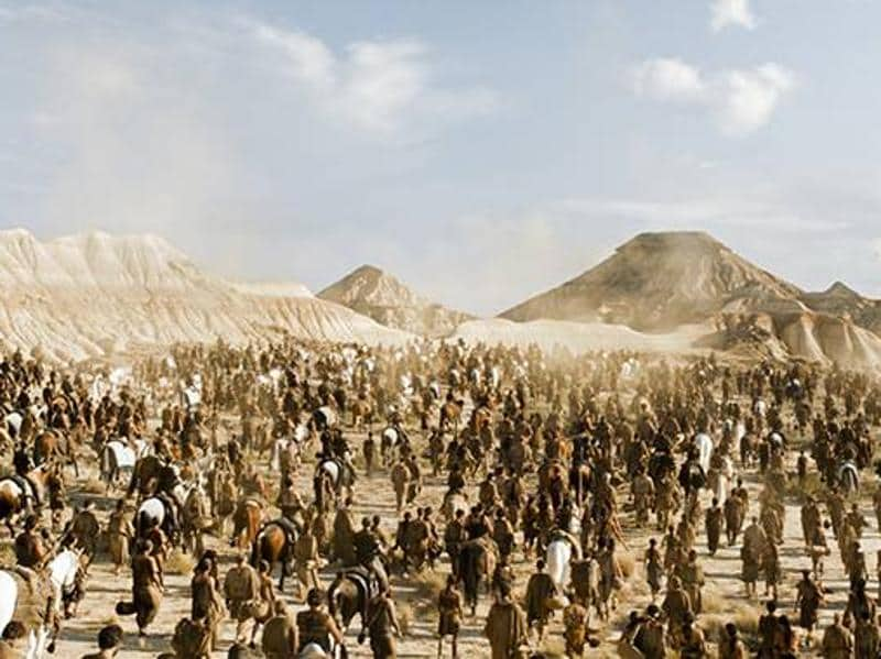 Dothraki men and women reaching the gates of Vaes Dothrak with Daenerys as their captive. (HBO)