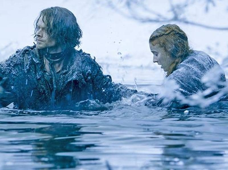 Theon and Sansa braving an icy river to escape the clutches of Ramsay's men. (HBO)