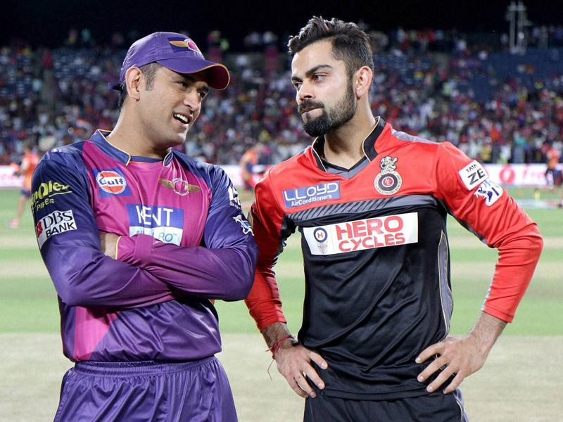 Rising Pune Supergiants captain MS Dhoni and Virat Kohli Captain of Royal Challengers Bangalore during their IPL match. (PTI Photo)