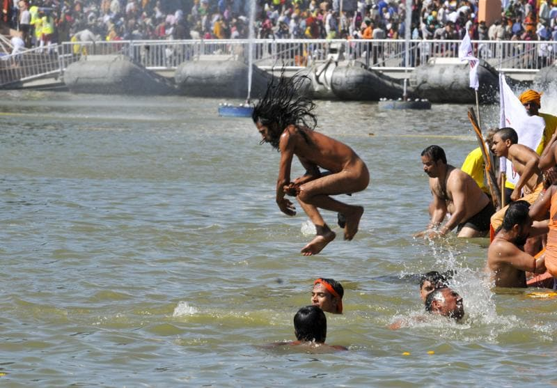 Sadhus belonging to thirteen different akharas took a dip one after the other, as per elaborate arrangements made by the authorities. Devotees believe that the holy bath cleanses you of all sins.  (Shankar Mourya/ Hindustan Times)