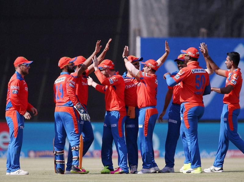 Ravindra Jadeja of Gujarat Lions is congratulated for taking the catch to get Shane Watson. (PTI Photo)