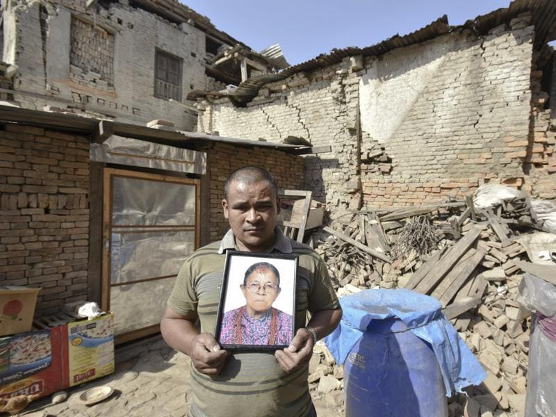 Rajendra Dankiya shows a photo of his mother who died in the devastating quake in 2015.  (Raj K Raj/Hindustan Times)