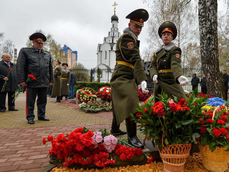 Honour guard soldiers lay flowers at the Chernobyl victims' memorial in Minsk. The exact number of casualties is unknown, largely due to the Soviet Union's initial attempts to cover it up. (AFP Photo)