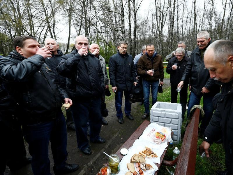 Men who took part in liquidation of consequences of the Chernobyl disaster, drink vodka to remember their deceased friends after the official ceremony in Minsk, Belarus. (REUTERS)