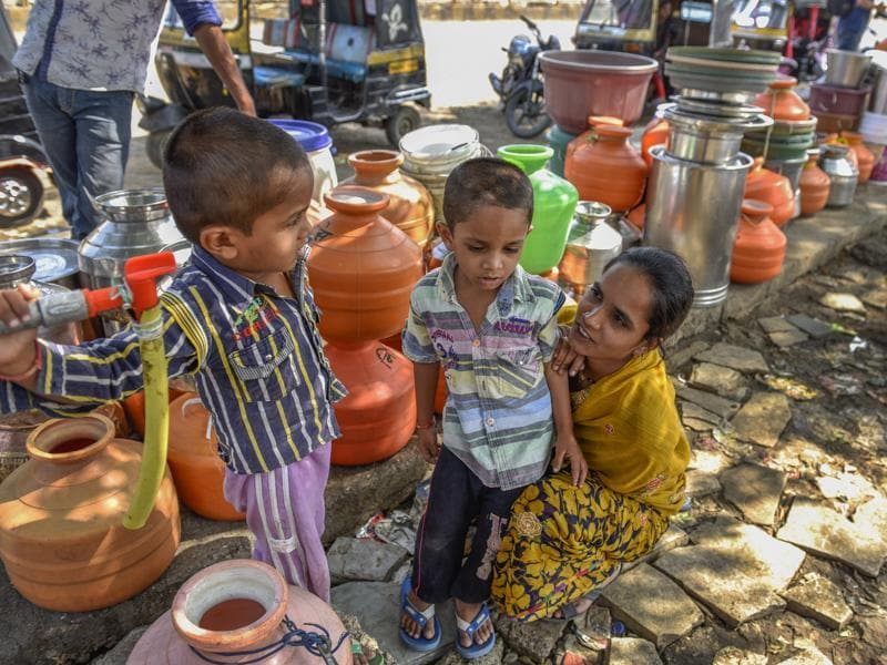 The lack of water has transformed the work day completely. Each day, women and children have to abandon all their work to queue up for five to six long hours to fetch water. (Satish Bate/Hindustan Times)