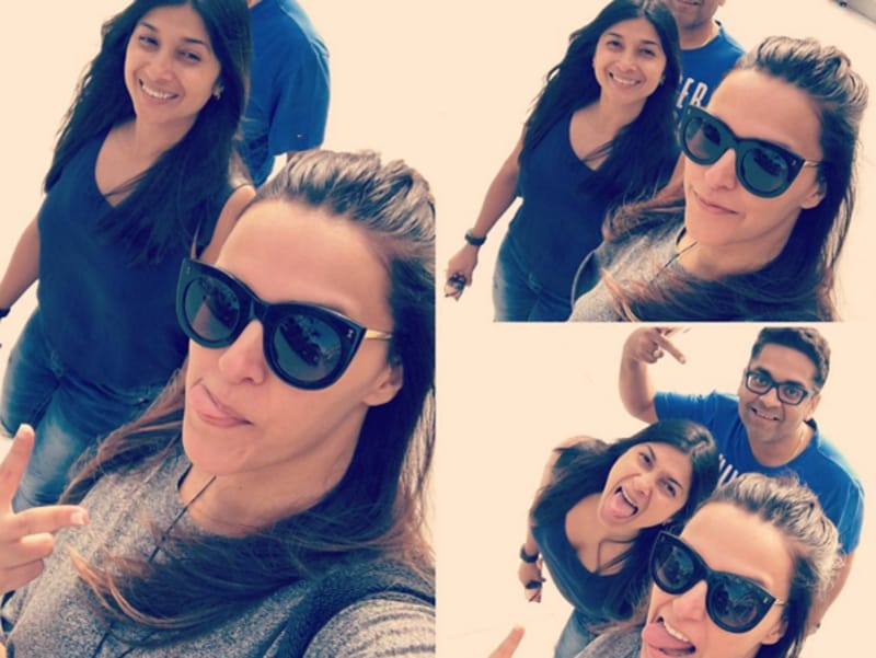A funny face contest is on against Neha and her friends... all part of the beach life. (Instagram)