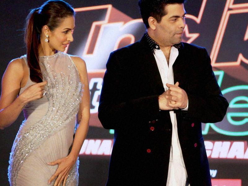 Both Karan and Malaika are popular show hosts on TV. (PTI)