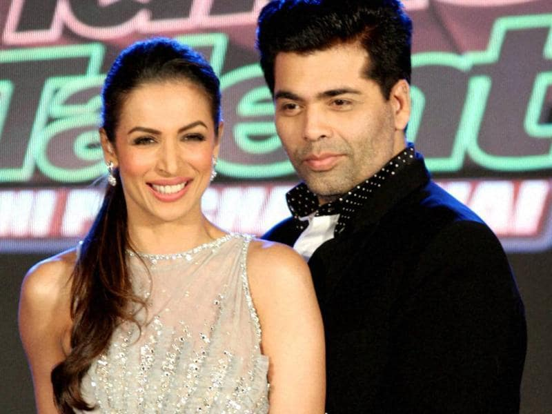 Filmmaker Karan Johar and actor Malaika Arora at the launch of a TV Show in Mumbai on Wednesday.  (PTI)
