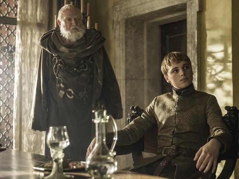Look at him, chilling on his thrones, sipping wine while his pretty wife rots in a cell. (HBO)