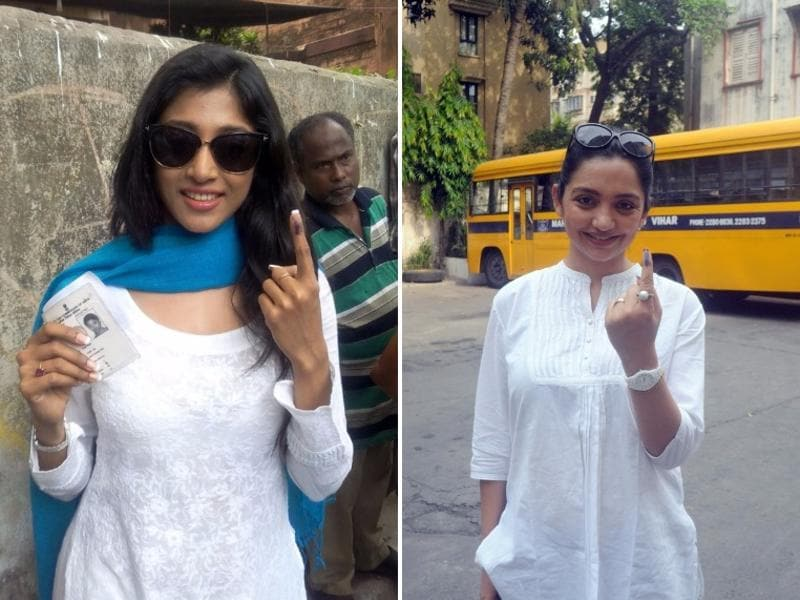 Actors Paoli Dam (left) and June Malia (right) outside a polling both in Kolkata.  (IANS)