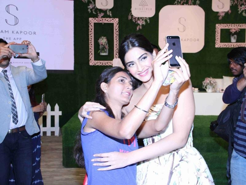 Sonam Kapoor clicks a selfie with a fan during a press conference organised to announce launch of her mobile application. (IANS)
