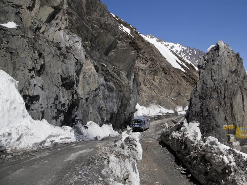 An Indian army vehicle drives through the Zojila Pass, which was closed since December 29 owing to heavy snowfall during winter. (AP)