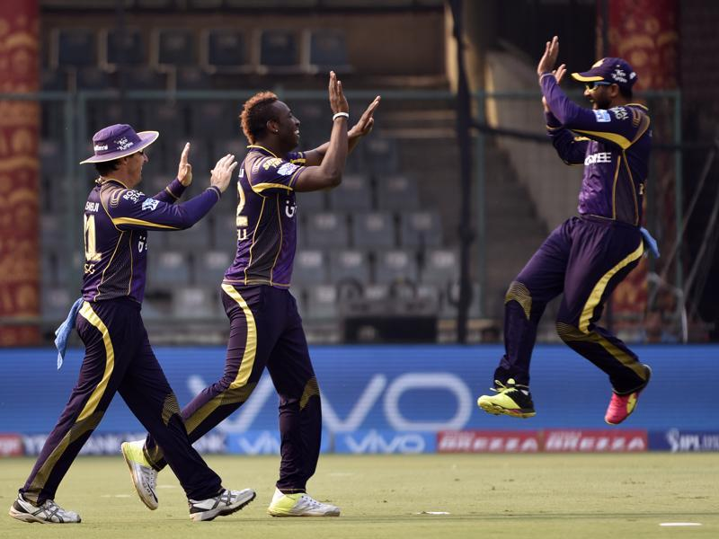 Kolkata bowler Andre Russell, centre, celebrates with team members after the dismissal of Quinton De Kock. (Virendra Singh Gosain/HT Photo)