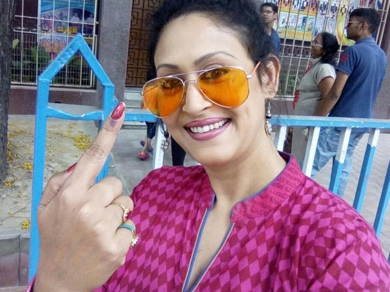 Actor Indrani Haldar posing for waiting photographers outside a polling booth in Kolkata.  (IANS)