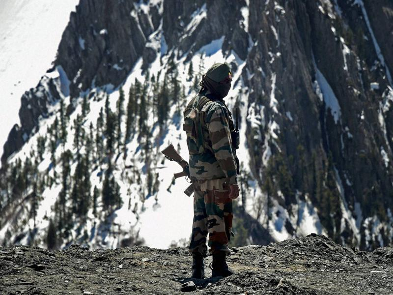An Indian Army jawan stands guard at Zojila Pass. Reiterating the strategic and economic importance of the highway, Lt Gen Dua said having a throughout-the-year open road is very advantageous for the people and for the forces. (PTI)