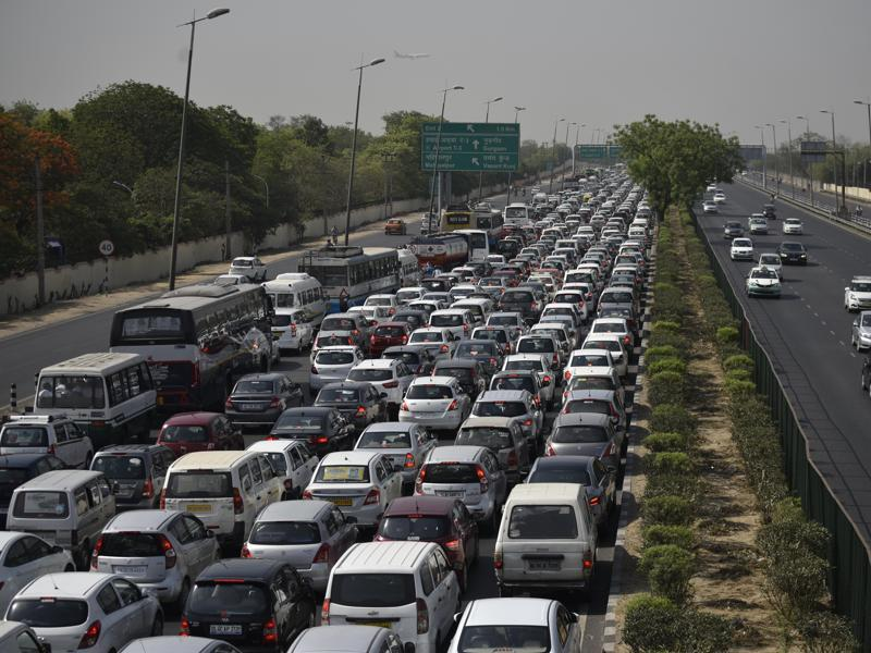 "Traffic on National Highway 8 came to a halt during the protest . The ban on diesel cabs came just days after the end of another two weeks of ""odd-even"" that kept about one million cars off Delhi's roads. (Vipin Kumar/HT Photo)"
