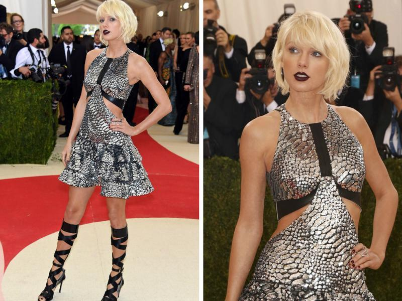 Taylor Swift went full metallic at Met Gala. The usually understated Swift ditched red lips for a cut-out silver Louis Vuitton dress with black lace-up heels. Don't miss the vampy black lipstick.  (AFP)
