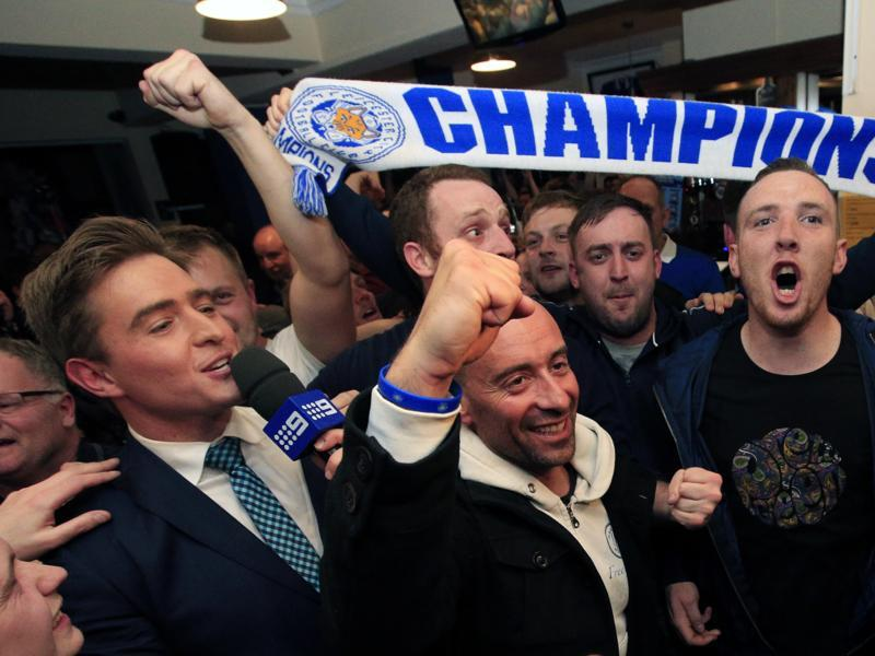 Leicester City fans celebrate in the Market Tavern in Leicester after seeing their side crowned English Premier League soccer champions following Tottenham Hotspur's 2-2 draw against Chelsea. (AP)