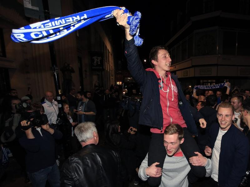 Leicester City fans celebrate in the streets of Leicester after seeing their side crowned English Premier League soccer champions. (AP)