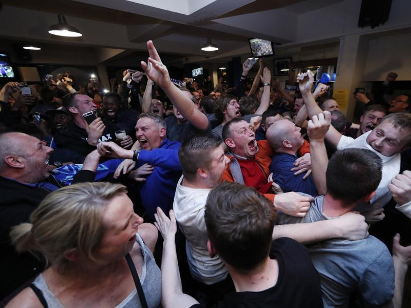 Leicester City fans celebrate winning the Premier League. (REUTERS)