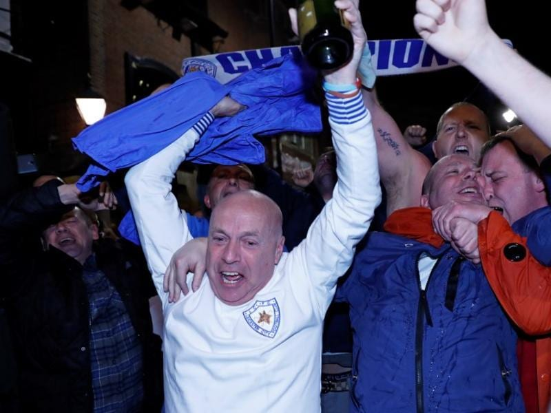Leicester City fans watch the Chelsea v Tottenham Hotspur game in pub in Leicester.