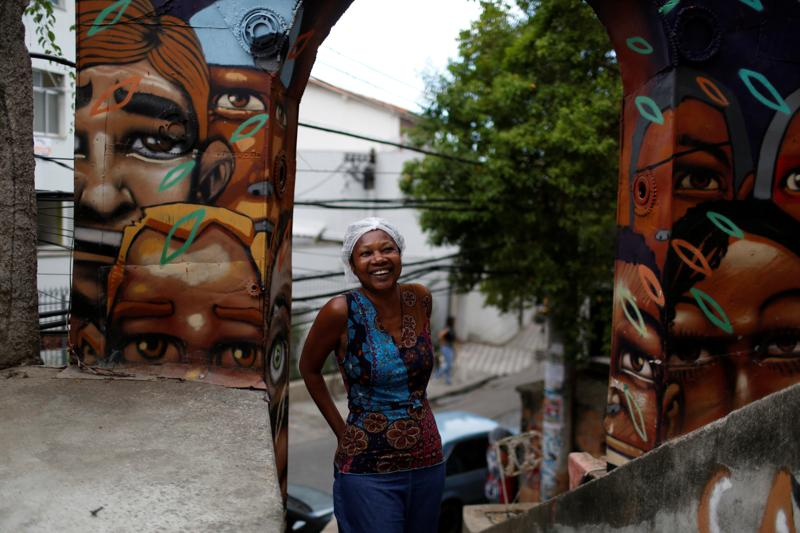 In recent times, there has been a growing interest in favelas as tourist locations. Ligia, the owner of Pousada Favela Cantagalo hostel, poses for a photograph near her hostel. (REUTERS)