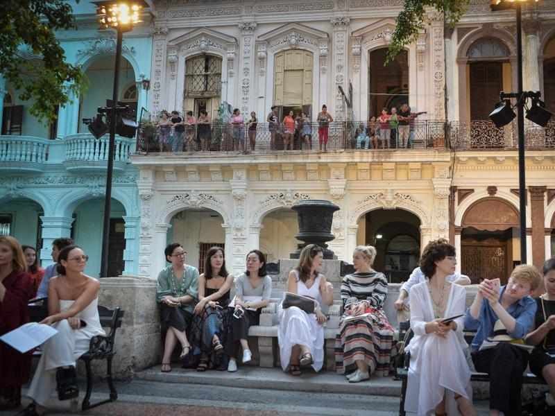 From their houses (at back) Cubans try to watch the Chanel performance at the Prado promenade in Havana. (AFP)