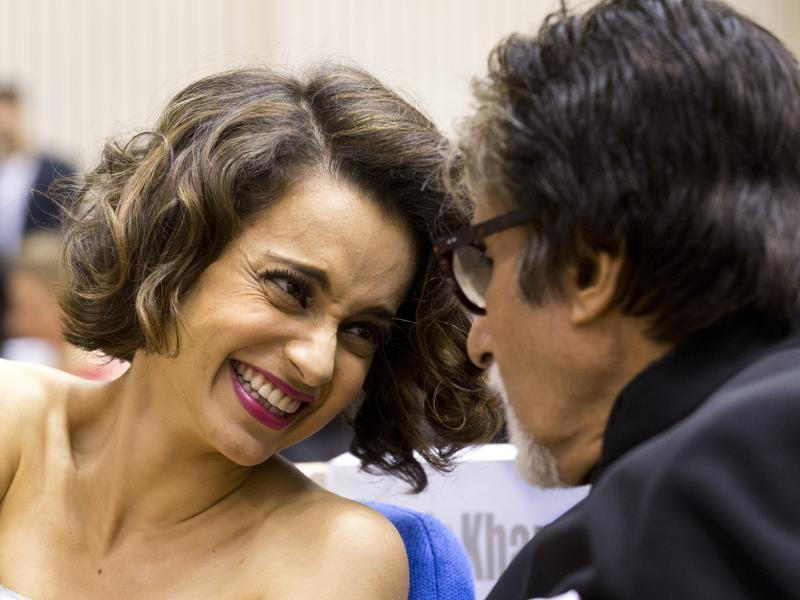 Kangana seems to be as happy as can be. She later described the win as her sweet revenge in the face of an ongoing legal spat with actor Hrithik Roshan. Here she is seen laughing at something Big B said. (AP)