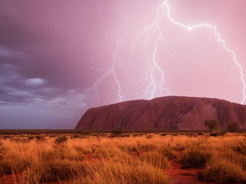 'Powered sight' in Yulara, Northern Territory, Australia: I had heard a lot about how beautiful Uluru should look like when it rains. But I never believed that I would see it with my own eyes because the red center of Australia is a very arid area. That's one of the reasons why Uluru is such a special place for the Anangu - the local aboriginal clan. If it rains, the water fills up the reservoirs around the rock, the only water source for several kilometers. This makes the Uluru Kata Tjuta National Park to special place for lots of rare animals as well. (Photo and caption by Christoph Schaarschmidt) (National Geographic)