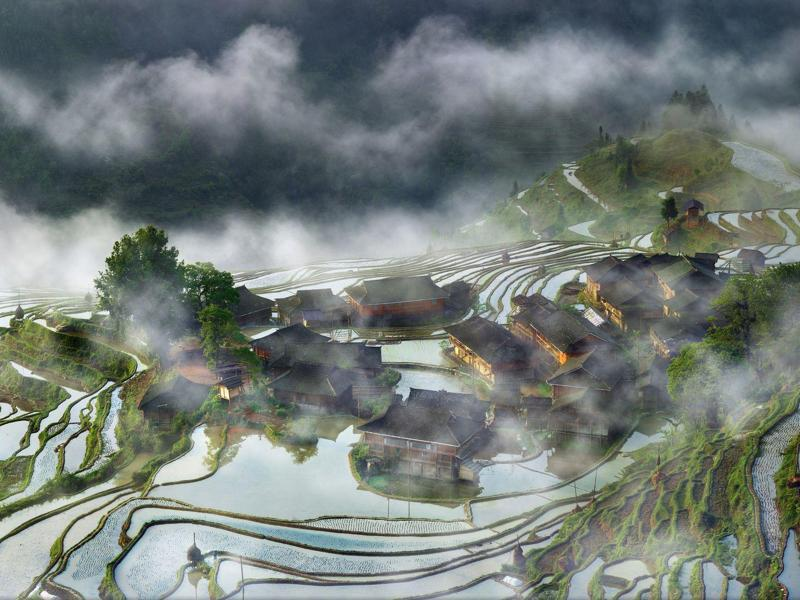 'Village in the mist': Captured this image early morning waiting for one week until I get the right mood of light and fog. (Photo and caption by Thierry Bornier) (National Geographic)