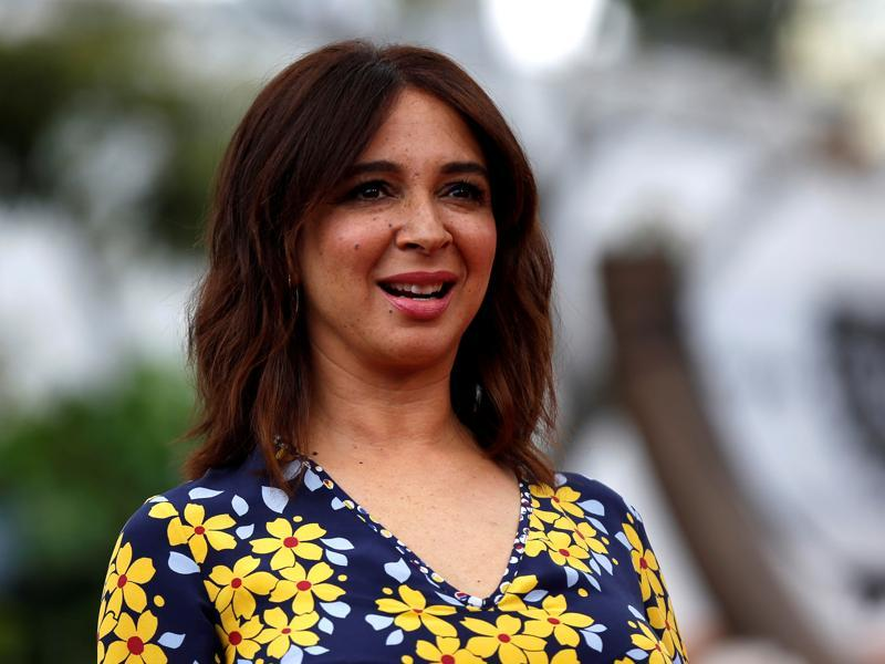 Maya Rudolph poses at the premiere in flowery sun-dress. (REUTERS)
