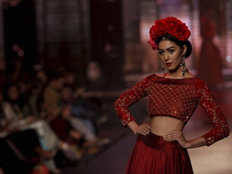 A model in a Yasmin Zaman ensemble at Bridal Couture Week 2016 in Karachi, Pakistan. The event brought an ensemble of nearly two dozen designers who showcased their bridal collections. (AP)