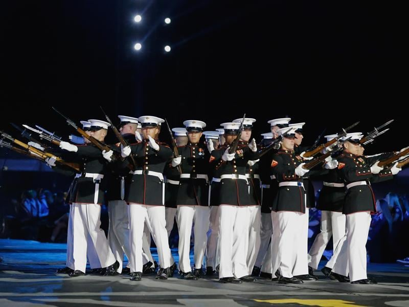 The US Marine Corps Silent Drill team performs during the opening ceremony. (AP)