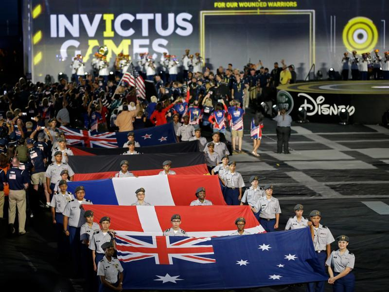Flags of some of the participating nations are displayed during the opening ceremony for the Invictus Games in Kissimmee. A total of 14 nations will participate in the games.  (AP)