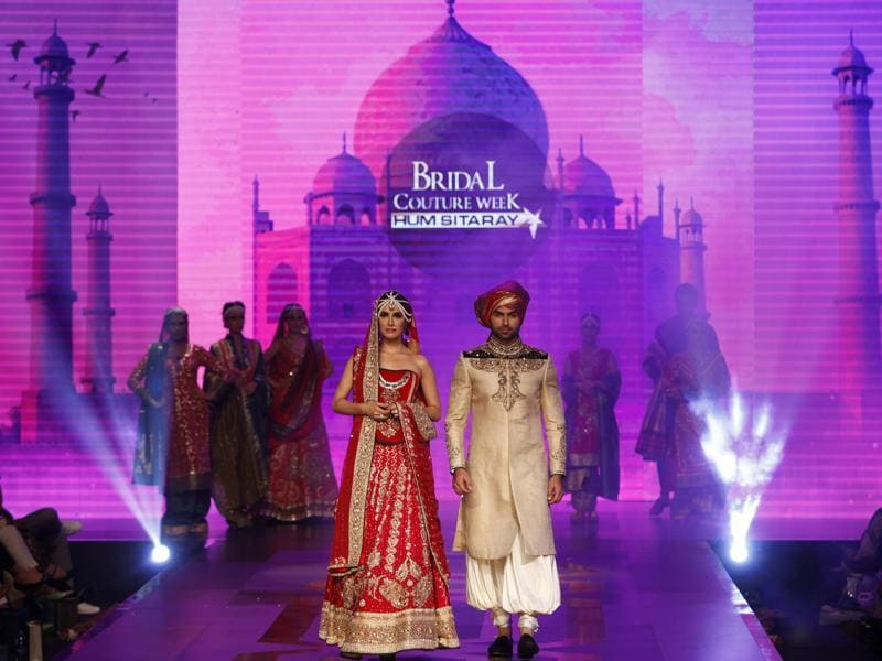 Models present creations by Pakistani designing label Kuki Concepts. (AP)