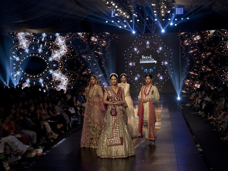 Models present creations by Pakistani designer Ayesha Ibrahim during Bridal Couture Week 2016 in Karachi, Pakistan. (AP)