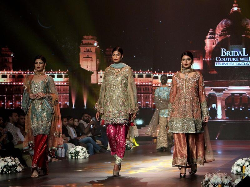Models present creations by Pakistani designing label Nickie Nina Concepts. The three-day bridal event continues till Sunday, May 8.  (AP)